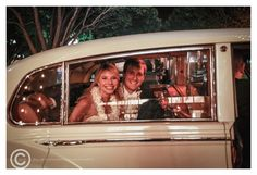 Bride and groom leaving spring wedding reception in vintage car with leis Just Mauied for honeymoon in Hawaii - Photo by Relive Photography by Laura Parent