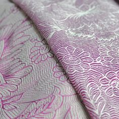 Etini Fuchsia is woven on an ivory warp with a magenta fill.  It is heavy  yet soft in hand, and provides superior support and snuggles.  Some  breaking in is required.  100% cotton | 330 g/m2    Not recommended for newborns or new wrappers.