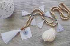 Neutral and white is the perfect combo  . https://www.seacircuscollections.com.au/products/vanilla-laau-tassel-necklace-snow-white
