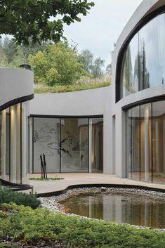 Futuristic Architecture Discover niko architect weaves organic futuristic house into artificial landscape in moscow Architecture Design, Organic Architecture, Pavilion Architecture, Residential Architecture, Contemporary Architecture, Landscape Architecture, Futuristic Home, Futuristic Architecture, Futuristic Design