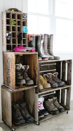 A vintage crate boot rack. A vintage crate boot rack. You can use as many crates you like to create this awesome shoe storage system - much more elegant than piling muddy boots on the floor.