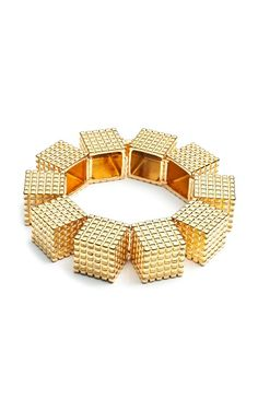 With a simple gown. Architectural. Supra Cube Bracelet