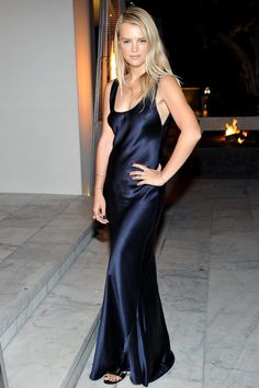 From Sienna Miller's sequin embroidery and Doutzen Kroes' immaculate silk to Dakota Johnson's plunging neckline and Zoë Kravitz in transparent lace and babouches, we see how the stars wear the latest it-trend of the season: the slip dress.