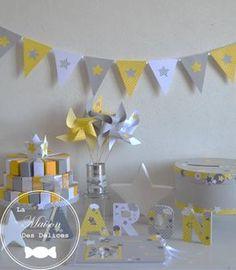 Ensemble baptême gris jaune et blanc, lettres prénom décorées,urne, livre d'or, guirlande de fanion gâteau de dragées et moulins à vents. Ensemble thème étoile…
