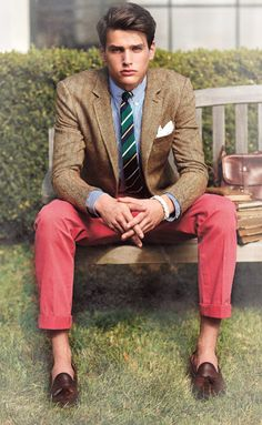 Work those colours! Brown tweed sport coat, light blue shirt, green striped tie, red pants