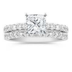 2.12 Carats total weight... 27 round diamonds set in platinum...1 carat princess cut center diamond...perfection.
