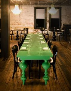 white washed brick walls. opulent chandeliers, and oh yeah...that Ilse Crawford green table :)