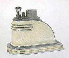 Cigarette lighter, chromium plated steel and white plastic, c.1925.