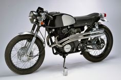 The terms 'hand crafted' and 'bespoke' get thrown around a lot these days—but in the case of this wonderfully understated 1969 Honda CB350, they're particularly apt. Virtually every part you see here has been hand made by Sean Pelletier of Roc City Cafe Racers.