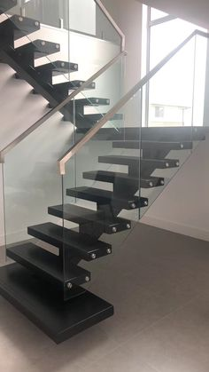 U Shape Stair Project in Melbourne Australia 17 risers, Thailand rubberwood black finish, 12mm clear tempered glass railing and top capping handrail Staircase Railings, Staircase Design, Stairways, Glass Stairs Design, Gate Wall Design, U Shaped Stairs, Glass Handrail, Black Stairs, Kings Mountain