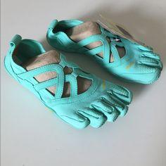 low priced 315a7 17a2f Vibram Shoes   Mint Colored Five Fingers Shoes   Color  Blue   Size  7