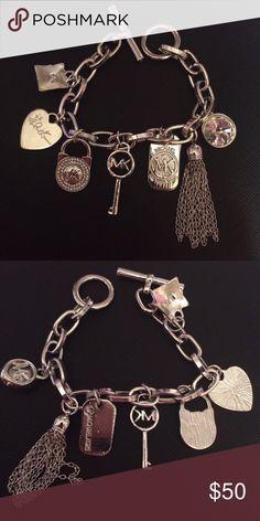 Rare Silver & Crystal MK Charm Bracelet - Logo Rare Silver & Crystal Michael Kors MK Charm Bracelet - Logo, Tassel, Heart, Key & Crystal. Michael Kors Jewelry Bracelets
