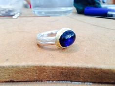 Iolite cabochon, Silver and 18ct Gold.