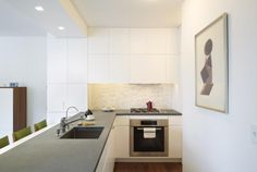 The tiny kitchen is airy and functional.