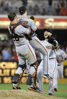 Tim Lincecum #55 of the San Francisco Giants is lifted by Buster Posey #28 after pitching a no-hitter during a  baseball game against the San Diego Padres at Petco Park on July 13, 2013 in San Diego, California
