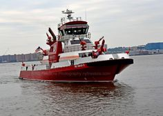 FDNY'S Fireboat, Firefighter II  It is the newest addition to the FDNY Marine Division which is assigned to Marine 9 on Staten Island.     The new fireboat is a 140-foot, 500-ton vessel, with a maximum speed of 18 knots and the capability of pumping 50,000 gallons of water per minute.  Photo by http://www.nyfirestore.com