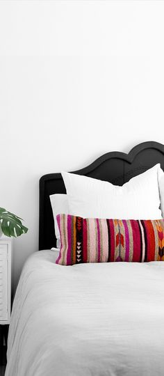 Say hello to my new favorite pillow! Handcrafted in Oaxaca, Mexico, this long lumbar pillow features Zapotec tribal patterns in bold, vibrant colors. This pillow takes all the guessing game out of finding the perfect pillow combinations – with this one piece, your room will take on a whole new look. #ad