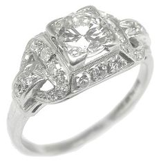 This is beautiful! A little ornate, but still absolutely beautiful. I love me a princess cut :)
