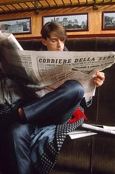 Paul Weller Timeline: Paul Weller of The Style Council reading an Italian newspaper