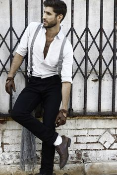 well put together outfit. suspenders together with a white custom dress shirt and leather loves.  perfect.