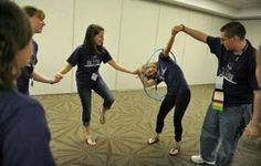 Students race to pass a hula hoop around each other while holding hands as they play cooperative games while participating in the Building Leaders And Strong Tomorrows Youth Group Games, Team Games, Youth Activities, Team Building Activities, Activity Games, Family Games, Fun Games, Party Games, Games For Kids