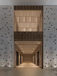 "I really like the idea of a ""se through"" wood panel for the exposed elevator.  I even like the stone to the right and left and the darker ""frame"" beneath the wood paneling Hall Design, Facade Design, Screen Design, Atrium Design, Design Hotel, Lobby Lounge, Hotel Lobby, Lobby Interior, Interior Architecture"