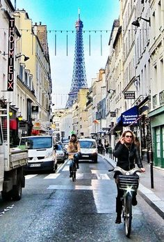 Women biking down the Rue St-Dominique with the Eiffel Tower in background.