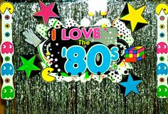 """For an """"I Love the 80s"""" pre-homecoming party, we started theme development with the photo backdrop, choosing the design elements and colors that we would weave into the rest of the event..."""