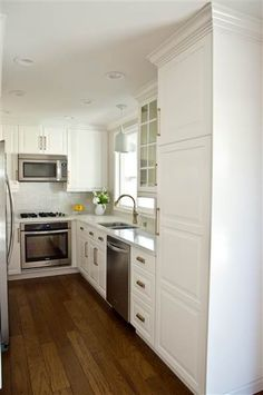 Ikea cab.-Interior designer, wife, and mom of three Stephanie Norris turned this home's drab kitchen into a functional space on a budget.