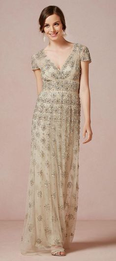 Love this v-neck, empire waist, Alexandrian loose dress that glitters, shimmers, and flows.