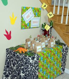 Dino  party- wrap posters in Dino wrapping paper and hang as decorations/banners and the footprints