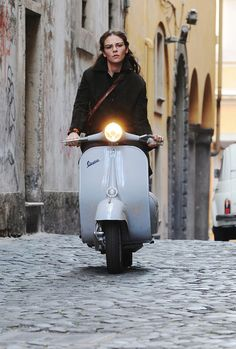 vespa Used as publicity shot for Italian film, maybe even a frame grab although this quality is high.