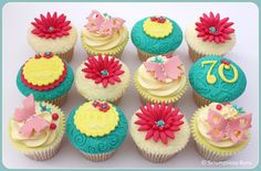 https://flic.kr/p/aaAvD5 | Bright Florals | 12 Madagascan vanilla cupcakes bought to celebrate a Mum & Nana's 70th Birthday... something bright for the young at heart :D  Visit my website or follow me on Facebook, Blogger or tweet me on Twitter  Sam x