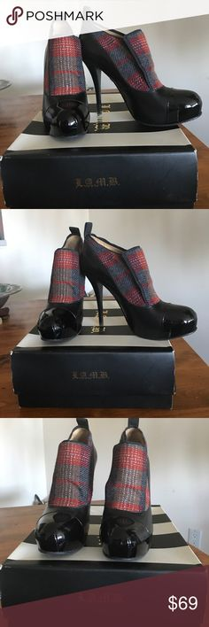 L.A.M.B. shoe booties only worn once size 9 High fashion shoe boogies. Black leather with a black patent leather toe. Beautiful plaid flannel insert that adds a high fashion statement. Only worn once excellent condition and like new! L.A.M.B. Shoes Ankle Boots & Booties