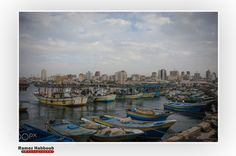 Port fishermen in Gaza City - Pinned by Mak Khalaf مرفأ الصيادين بمدينة غزة The port fishermen in Gaza City Photo by : Ramez Habboub Abstract GazaPortbeachfishermenfishingseaskysummersunsetwater by RamezHabboub