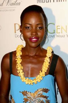 Lupita Nyong'o was honored with the Rainmaker Award at the 2014 Maui Film Festival on June 7, 2014 in Wailea, Hawaii. The actress wore a Fausto Puglisi dress with Christian Louboutin wedges and Vita Fede hoop earrings.