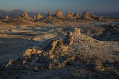 TRONA PINNACLES, ONE OF THE MOST UNUSUAL GEOLOGIC WONDERS IN THE CALIFORNIA DESERT.   This landscape consists of more than 500 tufa (calcium carbonate) pinnacles rising from the bed of the Searles Dry Lake basin. These tufa spires were formed underwater, 10,000 to 100,000 years ago, when Searles Lake established a link in an interconnected chain of Pleistocene lakes stretching from Mono Lake to Death Valley.