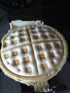 """Pizza (calzone style?) in a waffle iron! This site gives a recipe for """"Pizza Hut style dough,"""" which sounds good, but I may also try with pre-made biscuits... I also might try it without the sauce in the middle, and just dip the pieces..."""