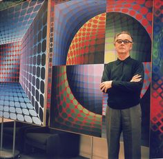 OP ART FAMOUS ARTIST: Victor Vasarely Biography: Vasarely poses in front of one of his Op Art paintings.