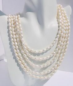 """Elegant Multi Strands Pearl Necklace Nothing compares with the cool creamy elegance of pearls.  This necklace is above all.    Necklace is made with 5 strands of Freshwater patato pearls.  The strands are  20""""  to 26""""  long with Sterling Silver Clasp.  Inclue Cuff Bracelet. Multi Strand Pearl Necklace, Strands, Beaded Jewelry, Jewelry Making, Pearls, Sterling Silver, Elegant, Bracelets, Classy"""