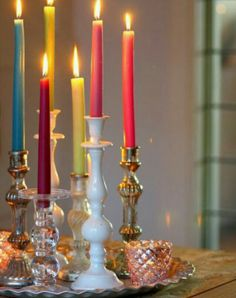imagine random candle holders with all white or mixed with your color of taper candle and/or different size candles--down center of table