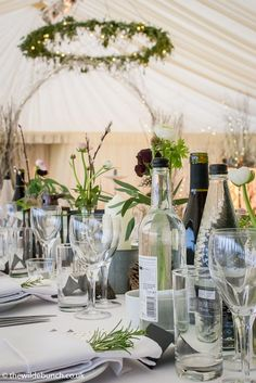 Marquee table centres over looking a hanging floral ring and arch. A Wilde Bunch design on New Years Eve 2016 Marquee Wedding, Table Centers, New Years Eve, Canopy, Garland, Wedding Flowers, Arch, Weddings, Table Decorations