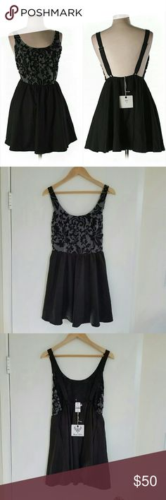 """NWT LF Black Gray Mini Party Cocktail Dress NWT black & gray mini dress. Features a black skater skirt. Great for New Years! 100% Polyester. Approx length is 32"""". Adjustable straps. Open sides. Fun play on an edgy cut w/ a more traditional raised print bodice. Sz 10 (Aus), which is a US 6. From LF. Retailed for $168. By Angel Biba.   The is a very small knick in the bodice. I zoomed in so you could see it juxtaposed to a zoomed out pic. It's not noticeable.  If unfamiliar, LF is a cross…"""