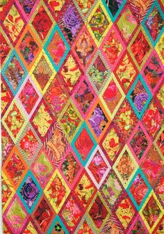 """Kaffe Bordered Diamonds quilt.   """"Focus, work fast, be absorbed by the vision, feel the choices."""""""