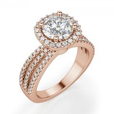 Like the city for which it is named, the Versailles engagement ring is sophisticated from every angle. The triple split band encrusted with accent stones supports the Contemporary Nexus Diamond™ within in a glimmering halo. The intricate detail on the sides of the setting bring to mind the beauty of European architecture, completing a substantial ring that is, in a word, stunning.  Center stone is available in a variety of carat weights; choose yours from the menu above. Complete the look…