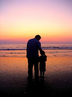 Father and son shot on the beach in Nags Head, North Carolina.