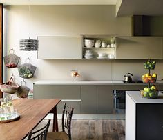 """The kitchen cabinetry is by Valcucine. The bags are from India, and the baskets are from Tanzania. """"I like things to feel accessible and not too precious in my collection, and in my home, too,"""" says Tia Cibani. """"I hate if things are just sitting there not being appreciated—I like things to be used."""""""