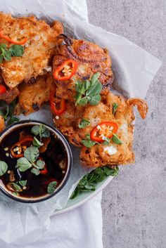 Crispy onion and feta fritters with spicy sweet chilli and soy dipping sauce. Vegetarian