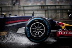 Rain master Sebastian Vettel rides the water during a wet qualifying session in Hungary. Many of the four-time world champions' best drives have come in such conditions.