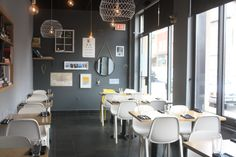 That single yellow chair. Emeco Broom chairs by Philippe Starck at Carben Restaurant in Ottawa, Canada. Broom chairs are made of 90% reclaimed industrial waste.